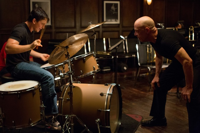 Miles Teller as the aspiring young drummer, Andrew Neiman, and J.K. Simmons as his abusive teacher.
